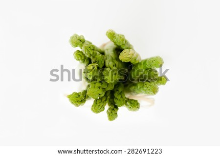 A bunch of fresh green Asparagus isolated on white. Top Shot. - stock photo
