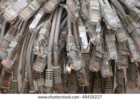 A bunch of gray network cables close up. - stock photo