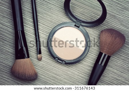 A bunch of make-up brushes and Cosmetics, Set of makeup brush and contour palette, Women accessories. (Vintage Style Color) - stock photo