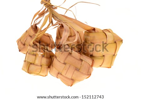 A Bunch Of Malay Rice Dumplings Wrapped With Coconut Leaf, Ketupat - stock photo