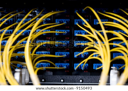 A bunch of network cables in a data center - stock photo