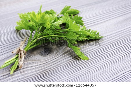 A bunch of parsley on wood background - stock photo