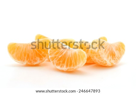 A bunch of peeled clementine orange wedges isolated over a white background. - stock photo