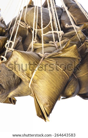 A bunch of steamed rice dumpling hanging isolated on white  background                                 - stock photo
