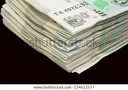 A bundle  of Russian rubles on black background - stock photo
