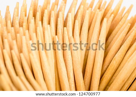 A bundle of wooden tooth picks. - stock photo