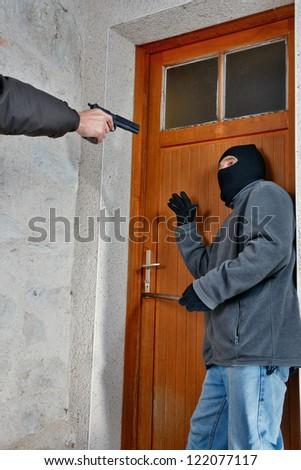 a burglar caught in the act of opening the door - stock photo