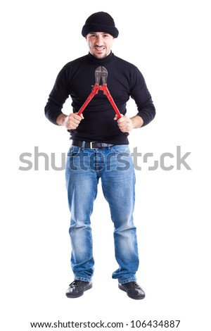a burglar or a thief holding big wire cutters - stock photo