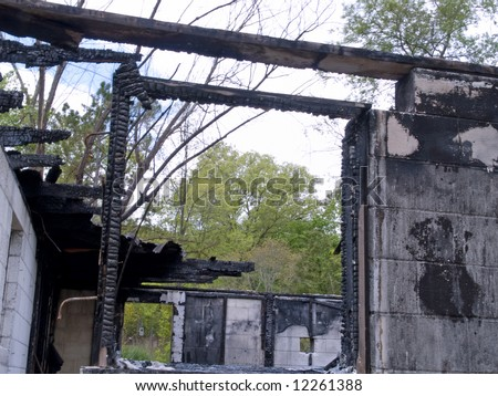 A burned out house - stock photo