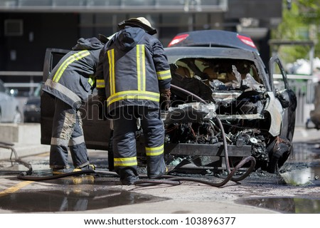 A burnt car - stock photo