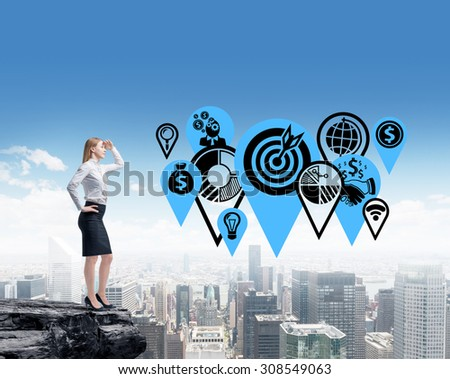 A business lady is planning business targets by standing in the rock. New York cityscape background. - stock photo