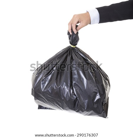 A business man arm holding a black bag of trash concept bad debt theme, bad investments, bad business - stock photo