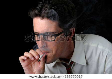 A business man enjoys a long pull on a joint. - stock photo - stock-photo-a-business-man-enjoys-a-long-pull-on-a-joint-133770017
