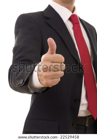 A business man giving the thumb-up sign (focus on the hand) - stock photo