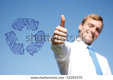 A business man giving thumbs up - stock photo