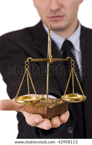 A business man holding a justice scale, isolated in white background - stock photo
