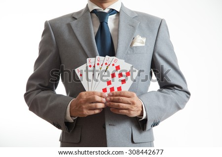 A business man holding cards - stock photo