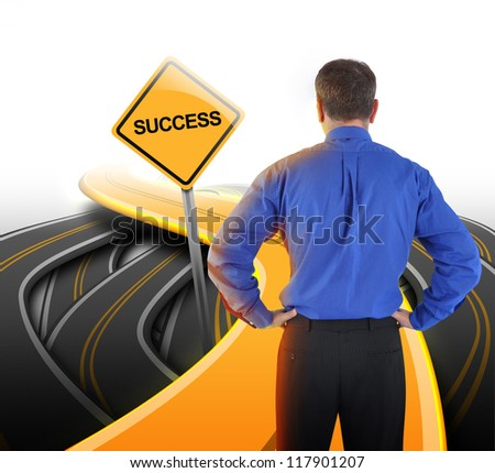 A business man is standing in front of a golden road with a yellow success sign to represent his path decision. - stock photo