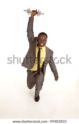 a business man lifting up a weight in the air trying to get a workout. - stock photo