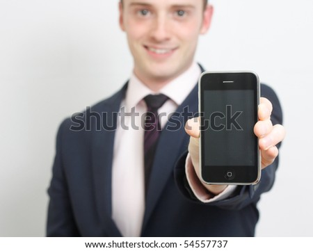 A business man showing his phone - stock photo