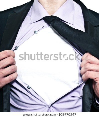 A business man tears open his shirt in a super hero fashion - stock photo