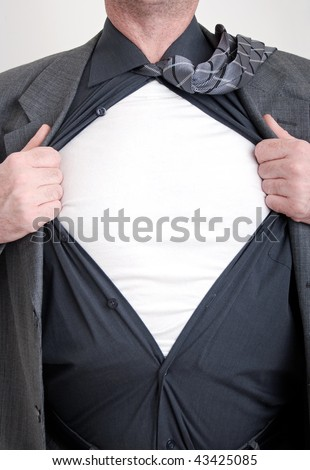 A business man tears open his shirt in a super hero fashion getting ready to save the day. - stock photo