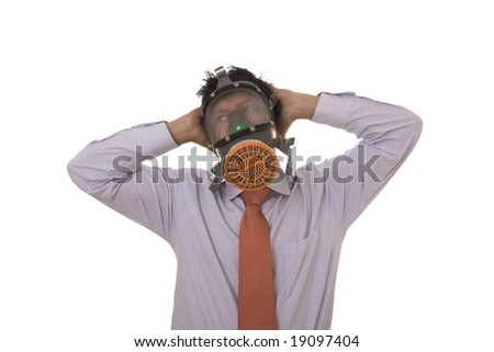 A business man with a gas mask on his face - stock photo