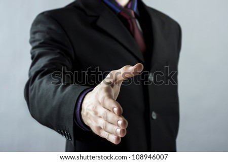 A business man with an open hand - stock photo