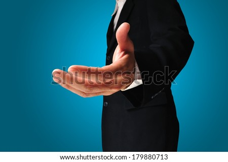 A business man with an open hand ready to seal a deal on white background with clipping path - stock photo