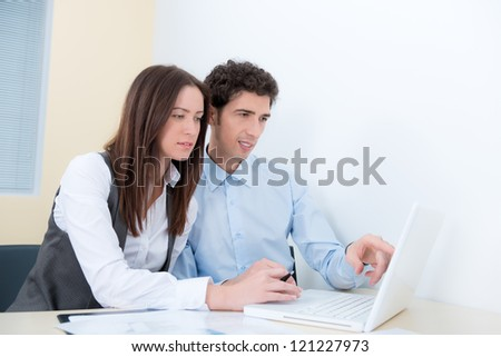 A business team are planning and discuss the project with a modern laptop. - stock photo