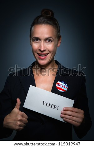 A business woman encouraging people to register to vote - stock photo