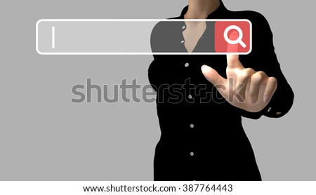 A business woman makes an online search by touching a search button. The cursor indicates the text to enter. - stock photo