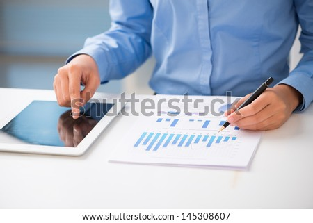 A businessman analyzing the strategy using his touchpad  - stock photo