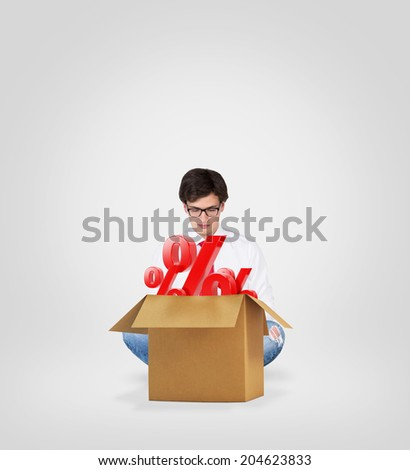 A businessman and a box with discounted goods. - stock photo