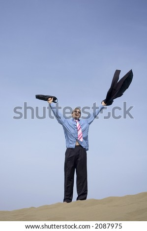 A businessman arriving for his first day on holiday in Maspalomas in Gran Canaria - stock photo