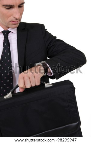 A businessman checking the time. - stock photo