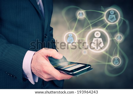 A businessman concept connecting with colleagues and friends over the internet. - stock photo