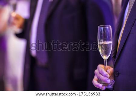 A businessman drinking champagne. - stock photo