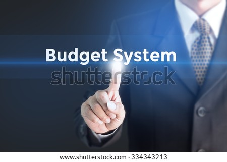A Businessman holding a white sign with the message Budget System. Can bring to the medium of your ad. - stock photo