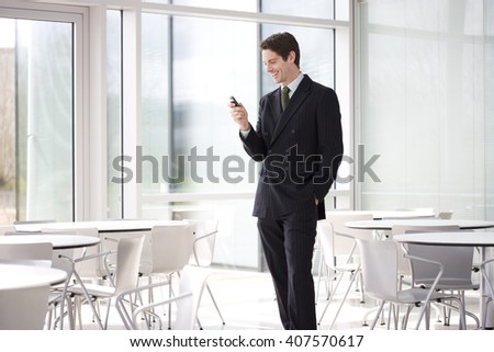 A businessman in a smart suit talking on a mobile phone - stock photo