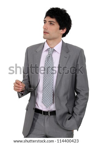A businessman looking in the distance. - stock photo