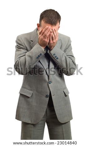 A businessman man crying into his hands, isolated against a white background - stock photo