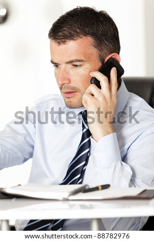 a businessman on the phone in office - stock photo