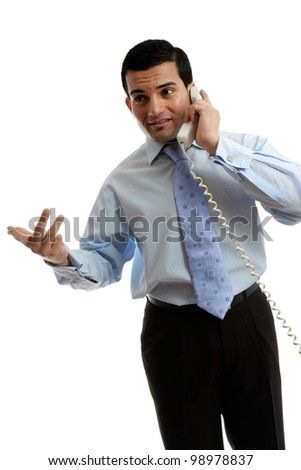 A businessman or salesman speaking effectively on the telephone.  White background. - stock photo