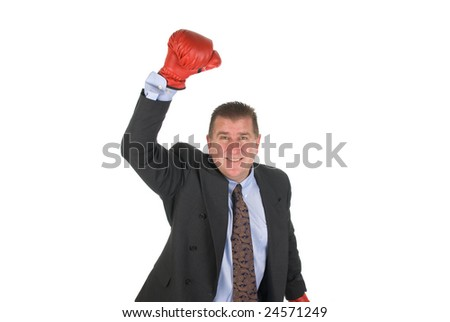 A businessman raises his arm in victory - stock photo