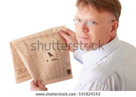 A businessman reading a newspaper , isolated on background - stock photo