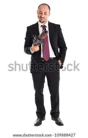 a businessman standing and holding a shotgun - stock photo