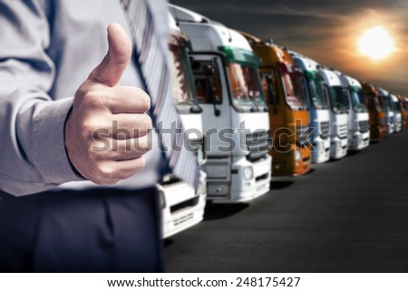 a businessman stick one's thumb in the air for cargo company - stock photo
