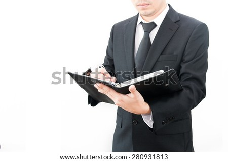 A businessman taking a note on his book - stock photo