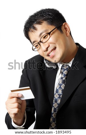 A businessman talking on the phone while holding credit card - stock photo